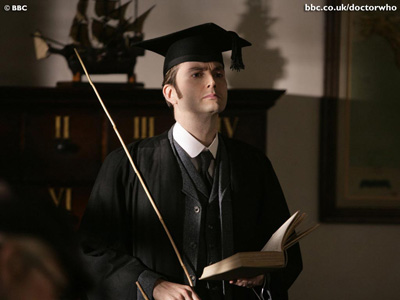 'The Tenth Doctor in a gown and mortar board, holding a cane' - from Abel and Haron's Spanking Blog